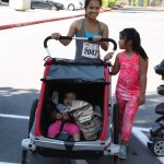 Awaiting start of run mother with huge stroller