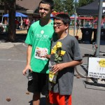 Nine year old cancer survivor and his brother after running race