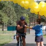 rider finishing under balloons